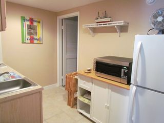Wildwood Crest condo photo - Kitchen with full sized refrigerator and microwave oven