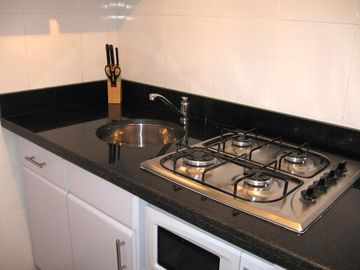 Gas stove, microwave, fridge, pots & pans