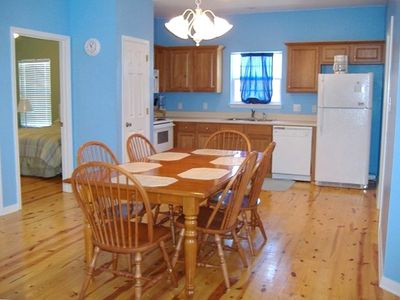 Spacious Dining/Kitchen area with view into breezy 2nd bedroom!