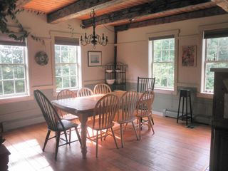 Rumney farmhouse photo - The dining room is open to the kitchen and living room.