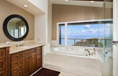 View from master bathroom, jetted tub, shower, and sauna