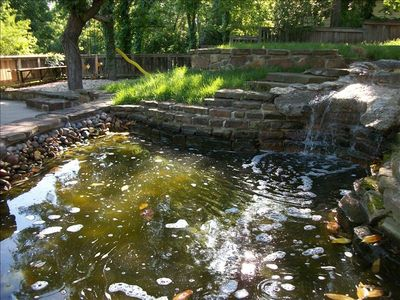 Cascading Waterfall into Pond  - Playground in the background