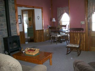 Jefferson farmhouse photo - Cozy den with gas fireplace, TV and table to enjoy the views or play games.