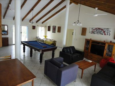 Spacious Dining and lounge room with its pool table.