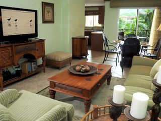 Playa Herradura condo photo - TV with 130+ channels, DVD player and stereo system.