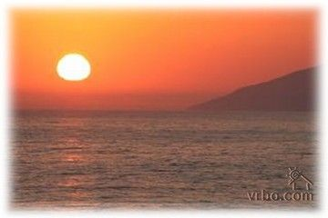 Pismo Beach condo rental - View of sunset from the private upstairs balcony patio off the master bedroom