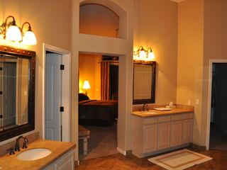 Scottsdale Troon house photo - View of the his & hers master bathroom with two granite vanities & marble floors