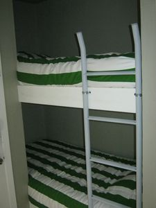 Galveston condo rental - Kids recharge here. New twin bunk beds.