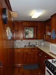 West Yarmouth cottage photo - Galley Kitchen with new range, refrigerator, microwave and washer/dryer