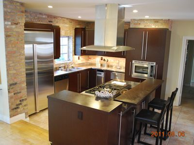 Incredible Chef's Stainless Kitchen with 6 Burner Dacor Gas Stove