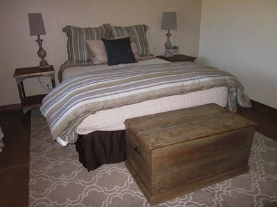 Queen bed in 1st guest room.