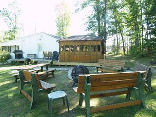 Wellston house photo - Fire Globe with Benches, Picnic Tables, 6 Chaise Lounges, Wooden Walkways, BBQ's