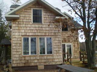 Lake Medora cottage photo - West elevation - (not shown- deck chairs, bbq grill)