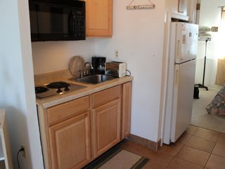 Kitchenette with full size fridge, full size microwave & two electric burners - Boardwalk condo vacation rental photo