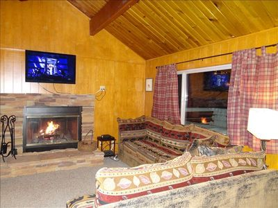 Cozy living room with fireplace and flat panel HD TV