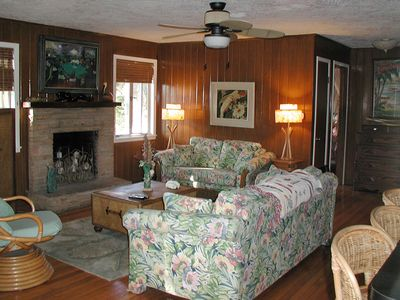 The living room has cypress walls, oak floors and a fireplace that burns candles