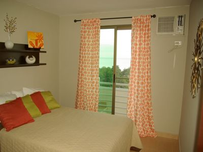 Third bedroom with double bed and walk out balcony with ocean view.