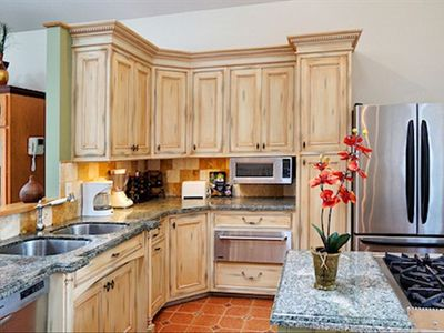 Indoor kitchen is completely updated with granite and stainless steel