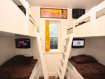 Four bunks! Four TVs! Four times more fun here!