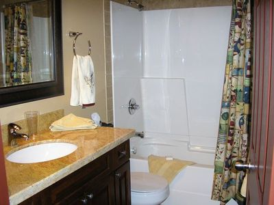 Main bathroom with shower/tub enclosure