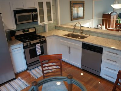 Newly remodeled, open plan, new cabs, granite counters, steel appliances, bar