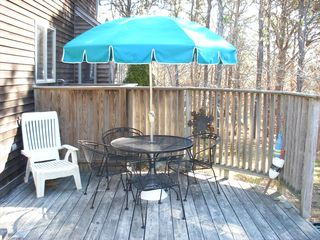 Eastham house photo - The back deck has a gas grill and easy access to the kitchen .