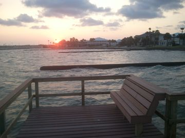 Rockport house rental - Sunset from new private pier over Aransas Bay at front of house