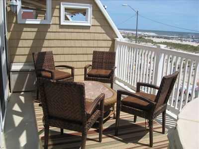 Ocean front deck with hot tub and retractable awning.