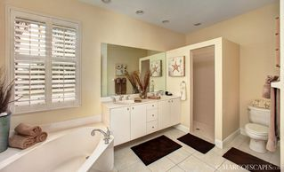 Vacation Homes in Marco Island house photo - Master Bath with Comfort Height His & Her Vanities