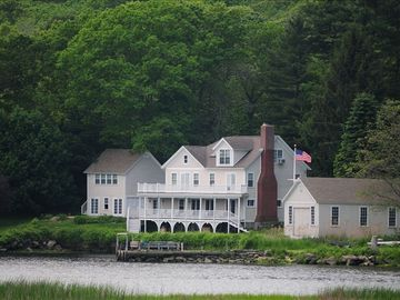 Mystic house rental - Riverview Cottage along with its boathouse and barn.
