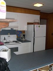 Portsmouth cottage photo - Kitchen with door to bunk room beyond