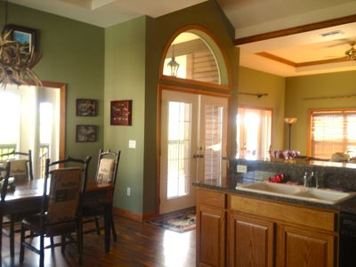 Inside view of kitchen, dinning, and living room.