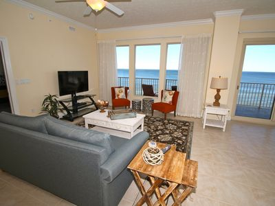 Living room with large flat screen tv, pull out couch and Spectacular ocean view