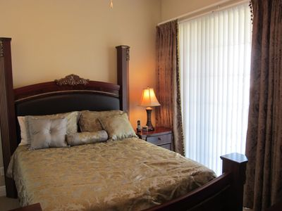 Wonderful Queen bedroom, sliding door to balcony over golf, LCD TV