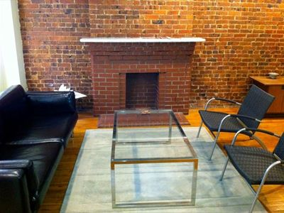 The Original Brick Fireplace May Not Work Any More But It's A Pretty Focal Point