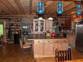 Gore Mountain lodge photo - Kitchen area -- includes 4 barstools at the island. Dishwasher and garbage disp