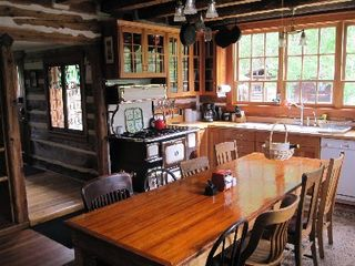 Gardiner cabin photo - kitchen, you may add two chairs to seat 10 at harvest table.
