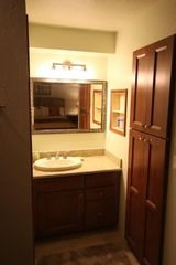 Poipu condo photo - Vanity and linen closet