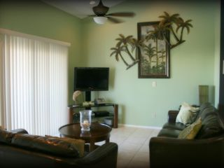 Indian Shores condo photo - Settle in for a night of movies & popcorn or a family game night of Scrabble.