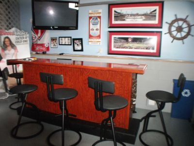 Garage/Bar Area with flat screen tv, outdoor refrigerator & Foosball table.