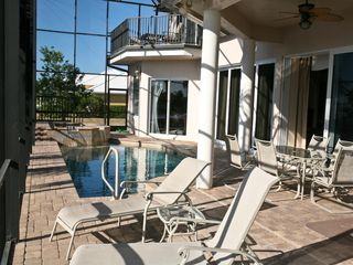 Vacation Homes in Marco Island house photo - Lanai with view of pool and second floor balcony / retreat.