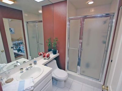 The adjacent second bathroom also has a separate shower.