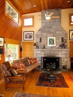 two story granite fireplace in Great Room which features maple floors