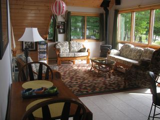 Interlochen cottage photo - Comfortable living room with a beautiful view of the lake