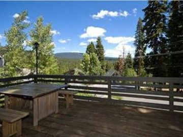 The back deck is perfect for summer time dining and mountain views!