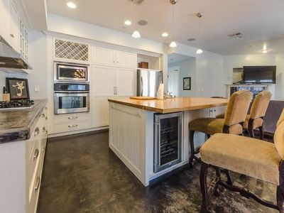 Kitchen with complete appliances including wine cooler