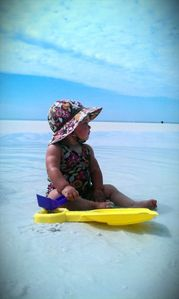 Our youngest daughter playing on the beautiful beach
