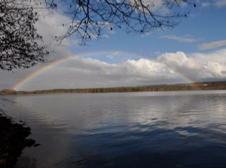 Unity cottage photo - Full rainbow over Lovejoy Pond after a May rainstorm