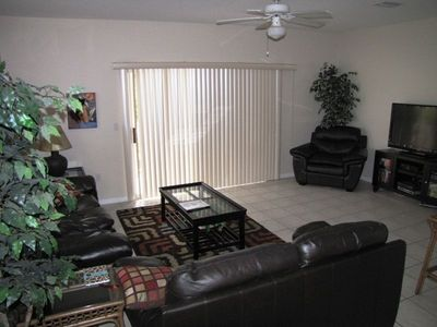 A spacious living room with large TV/VCR/CD Stereo opens onto large Lanai