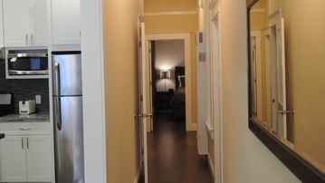 Hallway to bedrooms,bathrooms,and washer and dryer.